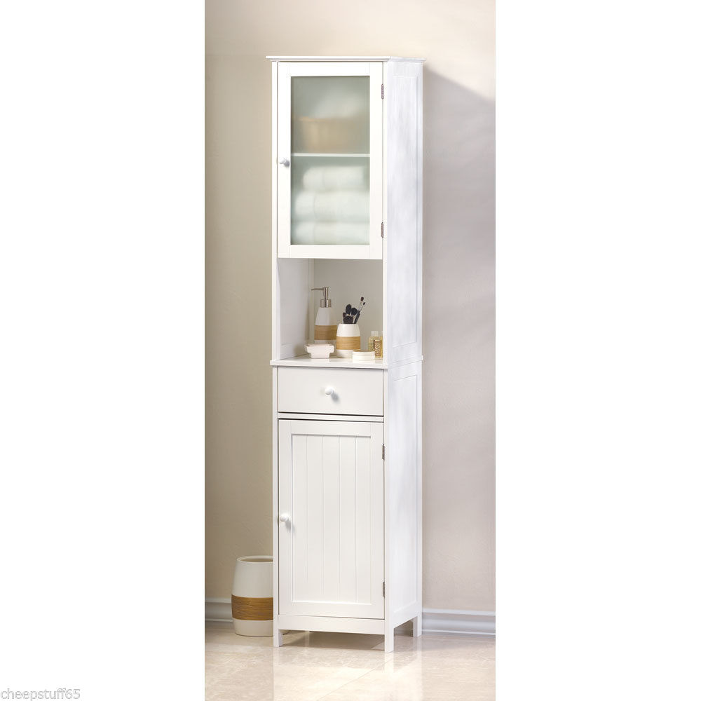 bathroom linen cabinet with glass doors