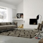 : brown leather couch with grey rug