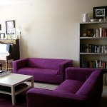 : brown sofa purple walls