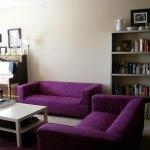 : brown sofa purple walls