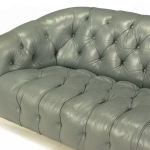 : grey leather tufted couch