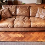 : worn leather couches