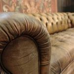 : worn look leather sofa