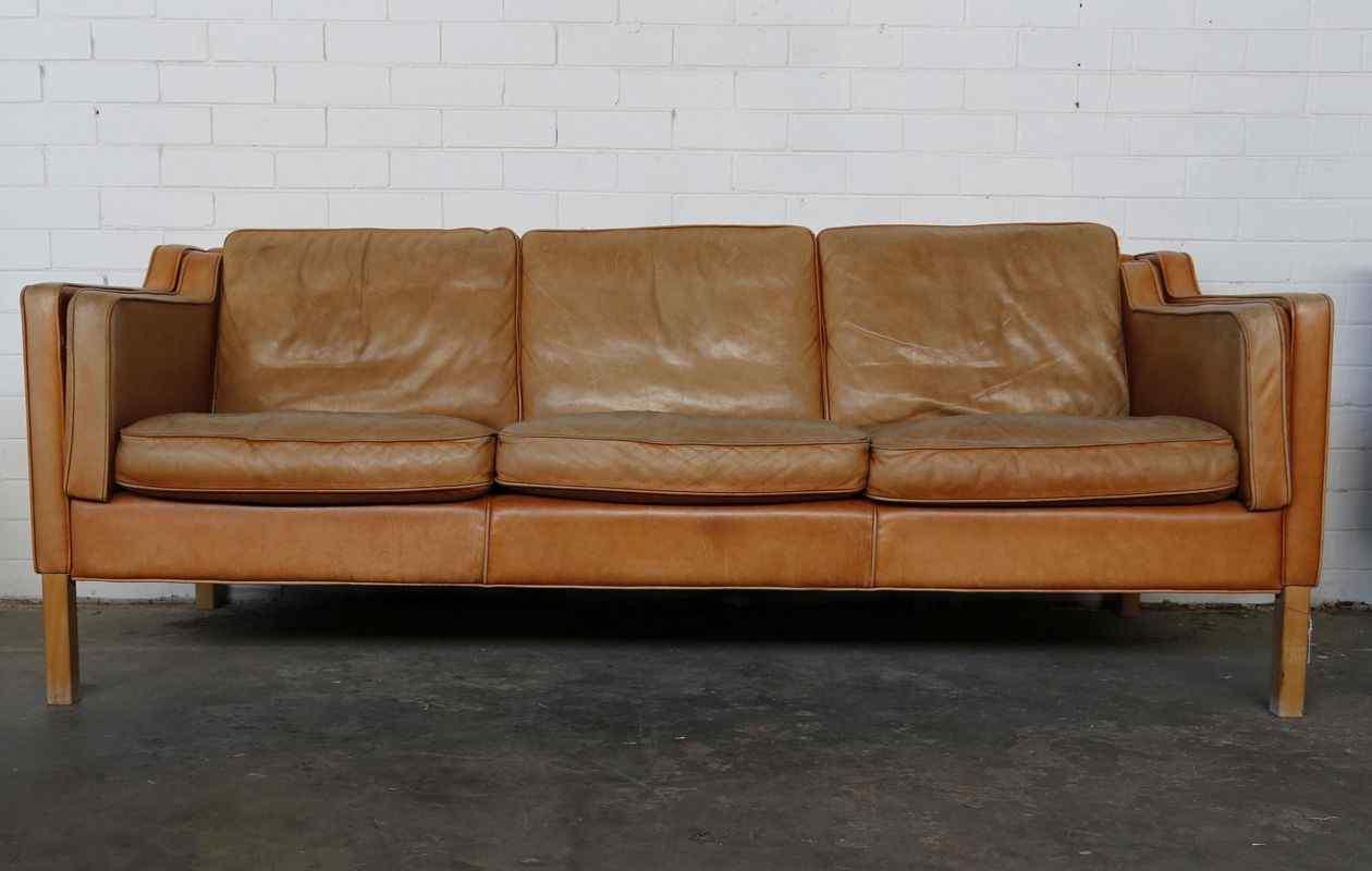 Worn Tan Leather Sofa
