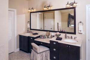 Double sink bathroom vanity with makeup table