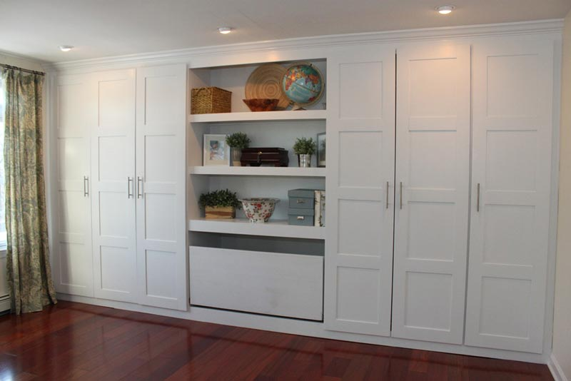 Ikea white wardrobe doors with handles.