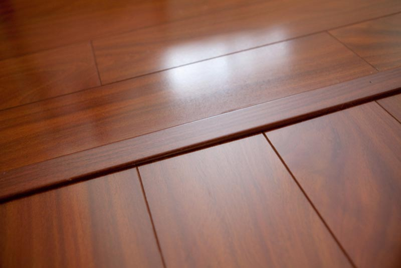 12mm African Mahogany High Gloss Laminate.