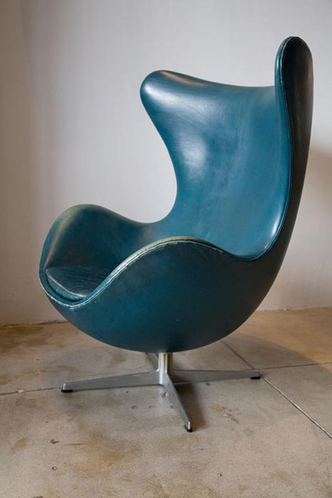 blue leather swivel club chair