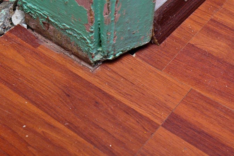 lay laminate flooring around doors