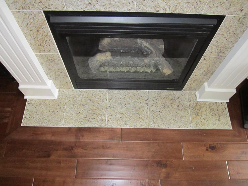 lay laminate flooring around fireplace