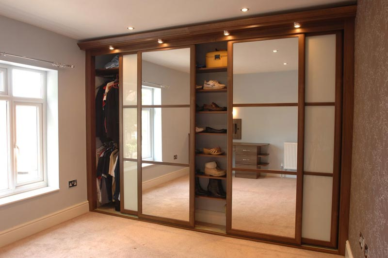 : bedroom wardrobe closet with sliding doors