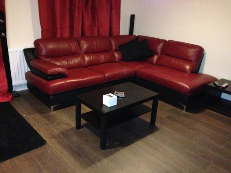 : dark red leather corner sofa