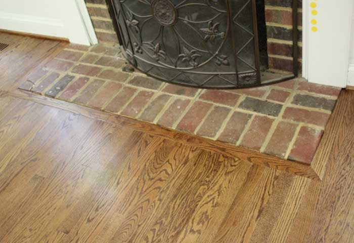 how to lay laminate floor around a fireplace