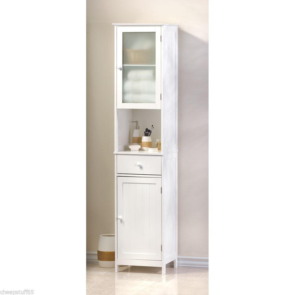bathroom linen cabinet with glass doors