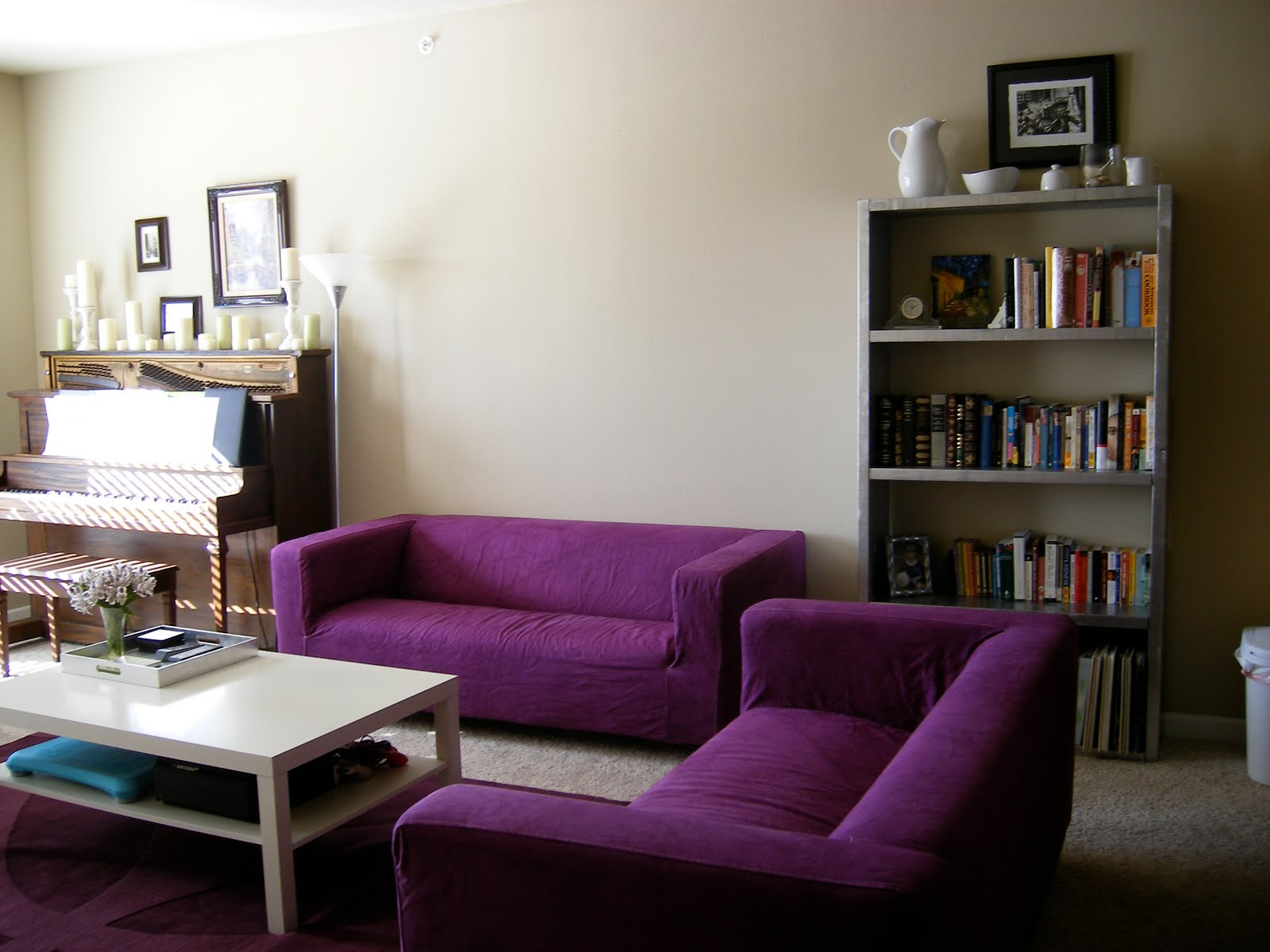 brown sofa purple walls