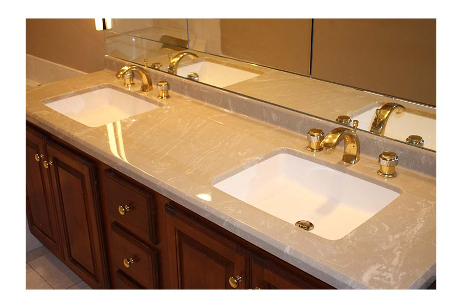 Bathroom vanities with tops and sinks and faucets
