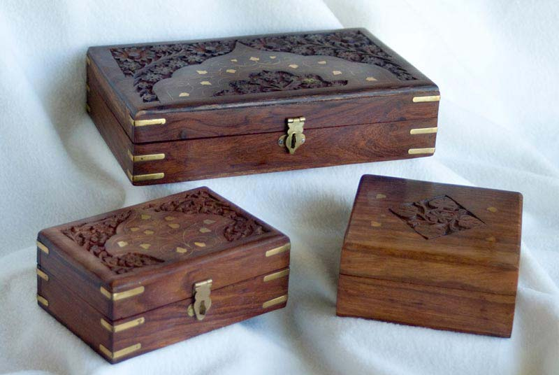 carved boxes made of wooden hand