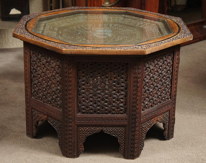 carved coffee table glass top